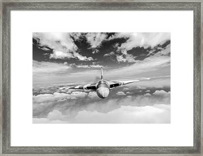 Framed Print featuring the digital art Avro Vulcan Head On Above Clouds by Gary Eason