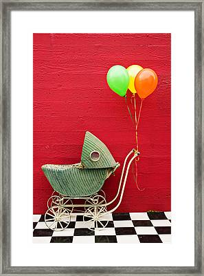 Baby Buggy With Red Wall Framed Print