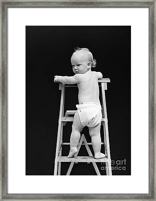 Baby Climbing Ladder, 1940s Framed Print by H. Armstrong Roberts/ClassicStock