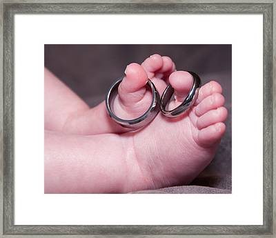 Baby Feet With Wedding Rings Framed Print