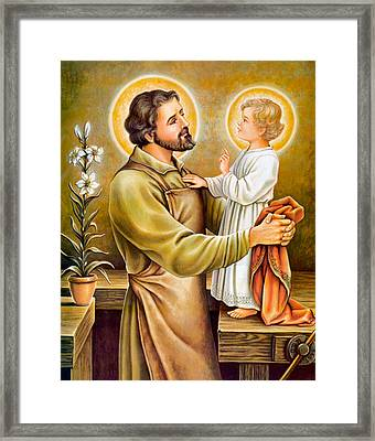 Baby Jesus Talking To Joseph Framed Print