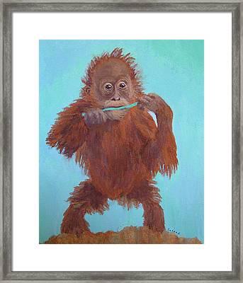 Baby Orangutan Playing Framed Print