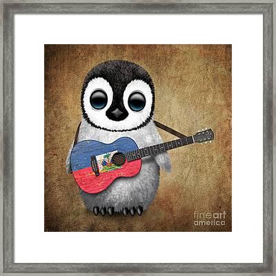 Baby Penguin Playing Haitian Flag Guitar Framed Print