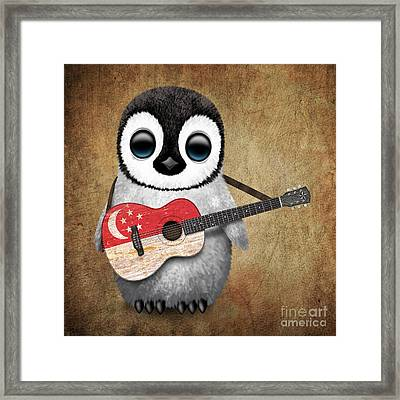 Baby Penguin Playing Singapore Flag Guitar Framed Print by Jeff Bartels
