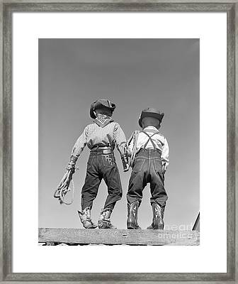 Back View Of Boys In Cowboy Costumes Framed Print