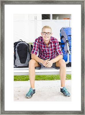 Backpacker Man Sitting At Bus Stop Framed Print