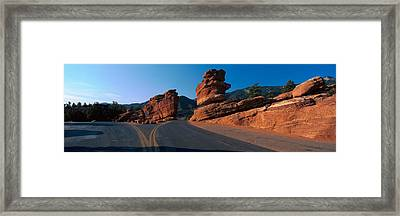 Balanced Rock And Road In Desert Framed Print