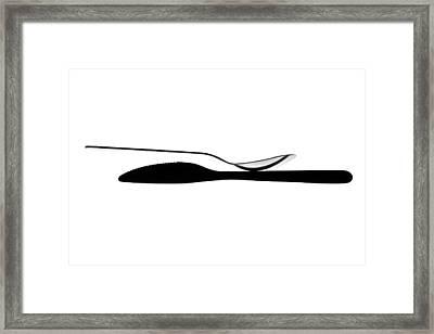 Balancing Spoon Framed Print