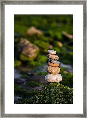 Balancing Zen Stones By The Sea Framed Print by Marco Oliveira
