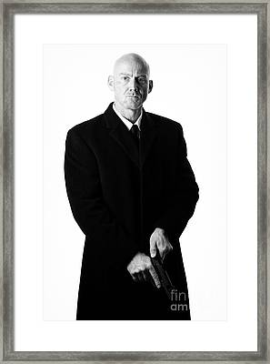 Bald Headed Man Wearing Heavy Black Overcoat Cocking Automatic Handgun Framed Print by Joe Fox