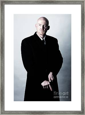 Bald Headed Man Wearing Heavy Black Overcoat Cocking Automatic Handgun Model Released Image Framed Print by Joe Fox