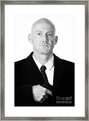 Bald Headed Man Wearing Heavy Black Overcoat Pulling Handgun Out Of Pocket  Framed Print by Joe Fox