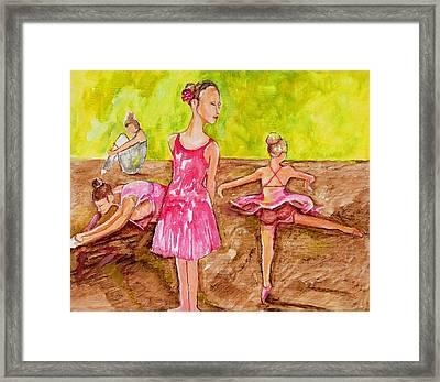 Ballerinas Stretching Framed Print by Nana Gale Van