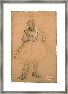 Ballet Dancer Adjusting Her Framed Print by MotionAge Designs