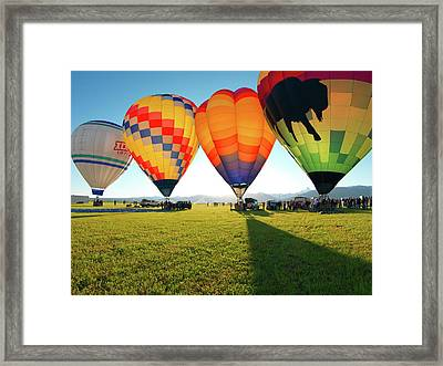 Balloon Glow Framed Print by Leland D Howard