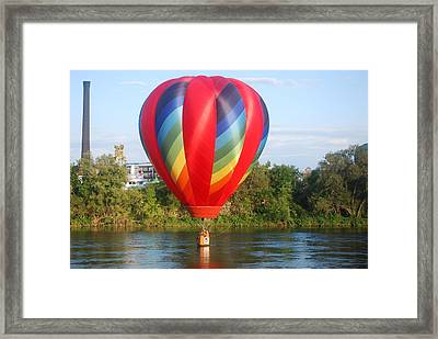 Balloon On The Water Framed Print by Alan Holbrook