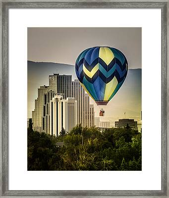 Balloon Over Reno Framed Print by Janis Knight