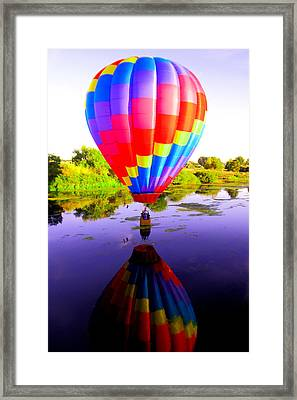 Balloon Touching The Water Framed Print by Jeff Swan