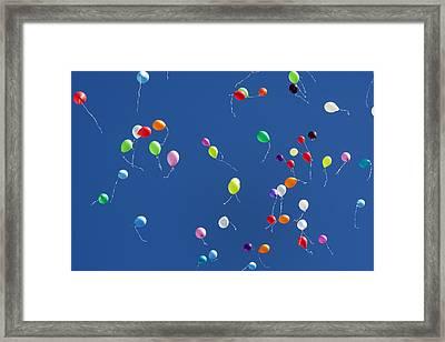 Balloons In The Blue Sky Framed Print by Luuk Van der Lee