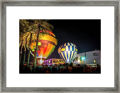 Balloons In The City Framed Print by Marvin Spates