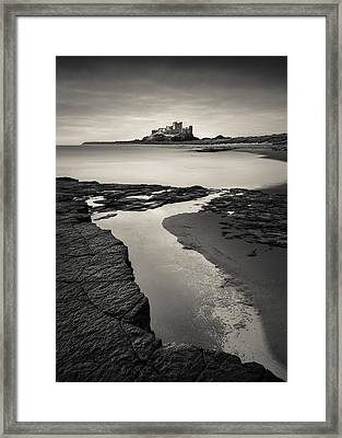 Bamburgh Castle Framed Print by Dave Bowman
