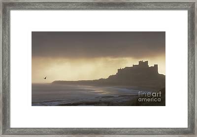 Bamburgh Castle In The Rain Framed Print
