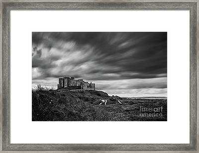 Bamburgh Castle Framed Print by John Farnan
