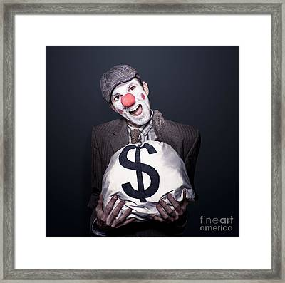Bank Robber Clown Running With Bag Of Funny Money Framed Print by Jorgo Photography - Wall Art Gallery