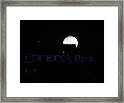 Banking On The Moon Framed Print by Roman Lezo