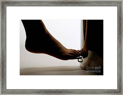 Bare Foot On Pedal Bin Framed Print by Sami Sarkis