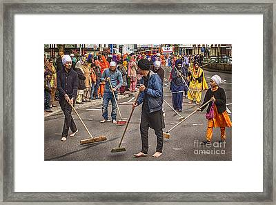 Barefoot Sweepers Framed Print by Nick Eagles