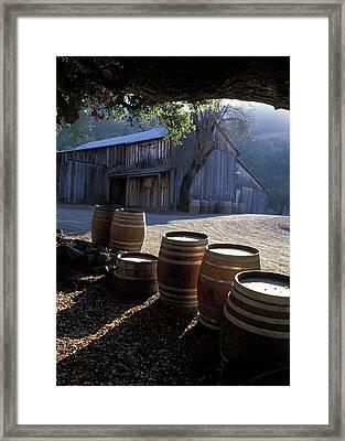 Barn And Wine Barrels Framed Print by Kathy Yates