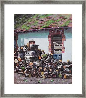 Barn With Log Pile Framed Print by Martin Davey
