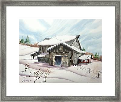 Barns In Snow Framed Print by Joseph Burger