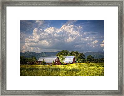 Barns Under The Clouds Framed Print by Debra and Dave Vanderlaan