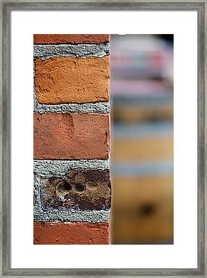 Barrel Behind Bricks Framed Print by Lisa Knechtel
