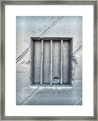 Bars In A Wall Framed Print by Tom Gowanlock