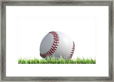 Baseball Ball Resting On Grass Framed Print by Allan Swart