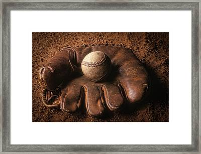 Baseball In Glove Framed Print by John Wong