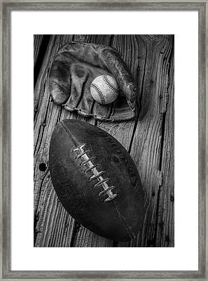 Baseball Mitt And Football Framed Print by Garry Gay