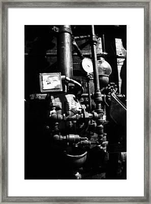 Basement Waterpipes Framed Print by Emma Jones