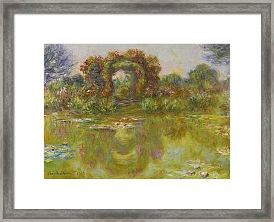 Bassin Aux Nympheas. Les Rosiers Framed Print by Claude Monet