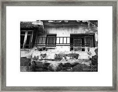 Battered Balcony Framed Print