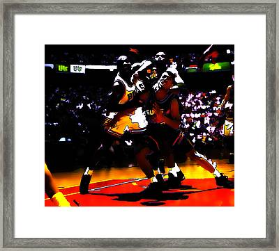 Battle In The Paint Framed Print by Brian Reaves