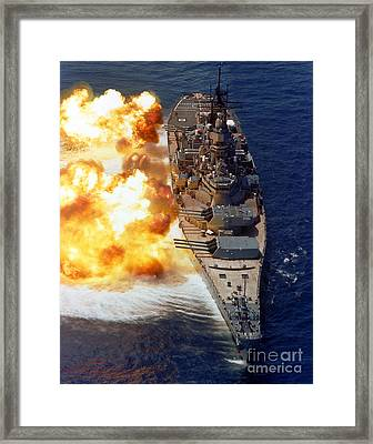Battleship Uss Iowa Firing Its Mark 7 Framed Print by Stocktrek Images