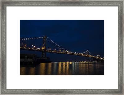 Bay Bridge At Night Framed Print by John Daly