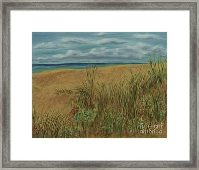 Beach And Clouds Framed Print