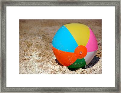 Beach Ball On Sand With Copy Space Framed Print by Paul Velgos