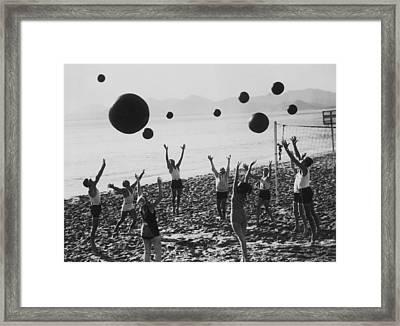 Beach Balls On The Beach Framed Print by Fpg