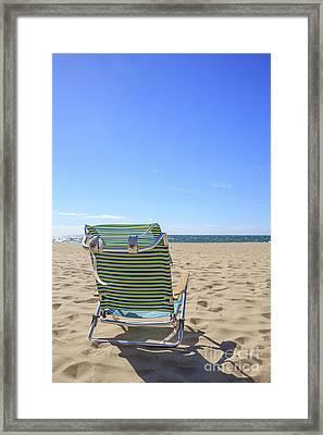 Beach Chair On A Sandy Beach Framed Print by Edward Fielding